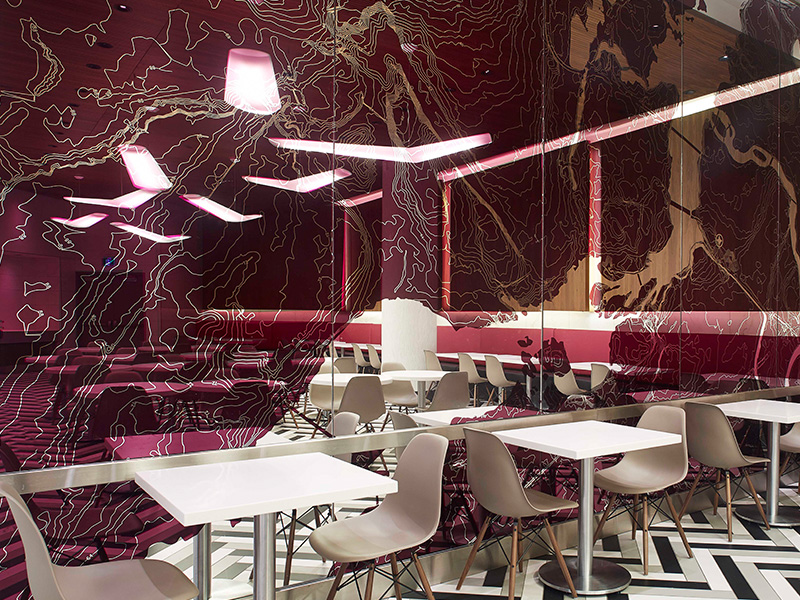 The pattern of the pink etched glass wall mirror in the side seating zone is a topographical map of Ottawa.