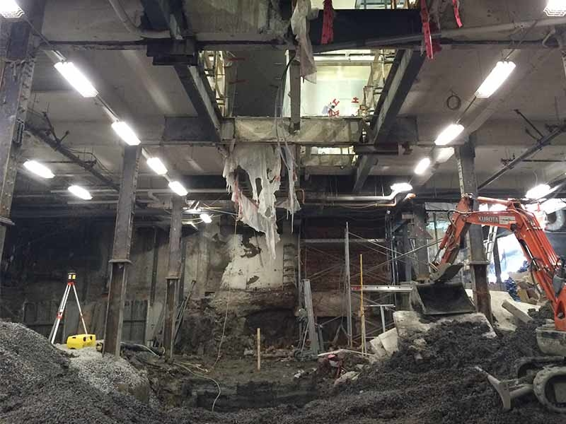 The existing basement level was excavated an additional 6 feet in order to accommodate supplementary sales area for the relocated men's department.